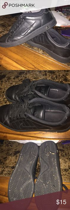 All black nike shoes Haven't warn in some years, still in great condition I really want to get them out of my closet so feel free to make REASONABLE offers! No damages as seen in the pictures  just little signs of wear. They were work shoes at one point, they're very comfy if you're on your feet all day!  Fast shipper: same or next day shipping guaranteed. Nike Shoes Sneakers