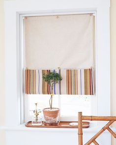 This simple shade is quickly and easily sewn and can be raised to two heights to let in varying amounts of light.