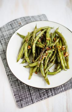 Garlic and Miso Green Beans: 12 ounces fresh green beans 5 garlic cloves (or more if you really love garlic) 3 teaspoons soy sauce 1 tablespoon miso paste 2-3 tablespoons olive oil 2 teaspoons sesame seeds (optional)