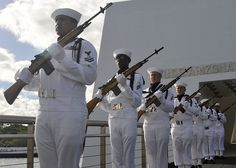 PEARL HARBOR (September 13, 2012) Navy Region Hawaii Honors and Ceremonial Guard prepare for a gun salute following an interment ceremony in honor of Pearl Harbor survivor at the USS Arizona Memorial. Lane served aboard the USS Arizona during the December 7, 1941 attacks on Pearl Harbor, and his ashes were buried with fellow shipmates lost during the attacks on Pearl Harbor. (U.S. Navy photo by Mass Communication Specialist 2nd Class Tiarra Fulgham/Released)