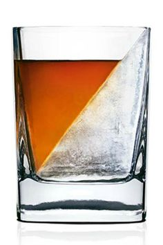 """A new slant on whiskey sipping. With the Whiskey Wedge, now you can keep your favorite spirits chilled without watering them down. Each unit comes with one Double-Old Fashioned Whiskey Glass and one silicone mold. Simply add water into the double old fashioned glass, insert the mold, then freeze. The ice forms into a wedge and, similar to a glacier, melts slowly due to the reduced amount of surface area.    Dimensions: 4"""" H X 3"""" W X 3"""" D Approximate Capacity: 1.5 fl oz.   Whiskey Wedge by…"""