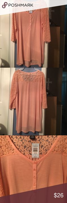 NWT TORRID Apricot Lace Henley sz 3 NWT TORRID Apricot Lace Henley has lace sleeves that go across the shoulders in back and come to a lovely rounded neck line.The shirt has a slight High Low bottom. Super soft. Perfect condition. Never been worn. Size 3. Tops Tank Tops