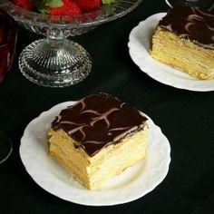 Flaky layers of thin dough, fragrant and buttery vanilla cream.... delicious (Napoleon Cake)