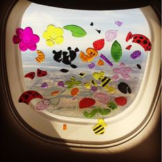 Keep your kid entertained by letting them play with some dollar-store gel clings on the window.