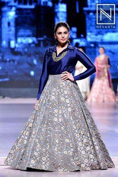 Huma Qureshi walked the ramp wearing an indigo blue shirt over a voluminous white Brocade lehenga by Manish Malhotra Indian Gowns Dresses, Indian Fashion Dresses, Indian Designer Outfits, Pakistani Dresses, Indian Wedding Guest Dress, Indian Wedding Outfits, Indian Outfits, Designer Party Wear Dresses, Lehnga Dress