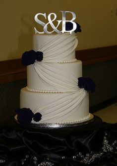 wedding cake - not sure about initials on top but like the cake...but it matches the design of your wedding dress