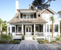 Coastal craftsman. Like the boardwalk in front of the house.