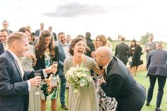 Bouquet Toss Wedding - Godwick Hall Wedding With Bride In Anna Georgina Bridesmaids In Green Sequinned Dresses Images From Sarah Jane Ethan Photography