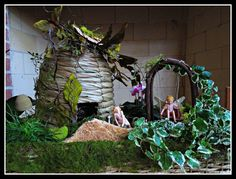 Fanciful Enchanted Garden with Handcrafted Bee Skep and Fairy on a Swing