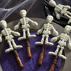 Transform pretzels into sweet skeletons for Halloween using Wilton Skeleton Bones Candy Mold and Candy Melts candy.