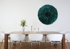 green juju hat on wall