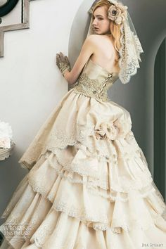 vysanthe:    game-of-style:    Myrcella Baratheon's wedding dress - Jill Stuart Wedding Collection 2011    Reminiscent of things I would want on my wedding dress - open back, beige/ivoryish colour, bustle, plenty of lace, corset lacing! (Though I can't decide between lacing or millionsofbuttons)    This would make such a darling dress for a mori wedding! :-)