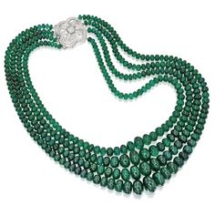 18 KARAT WHITE GOLD, EMERALD BEAD AND DIAMOND NECKLACE The graduated four strands composed of emerald beads weighing approximately 850.00 carats, completed by an openwork clasp set with small round diamonds, length 17 inches.