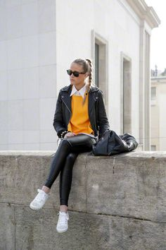 fall oufit black leather pants, white shoes, leather jacket, orange sweater and white shirt