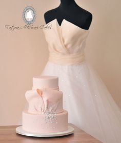 Cake inspired from simple and elegant engagement dress with a choice of vanilla cake with strawberry filling