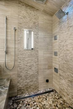 this shower is lined with body sprayers rainshower head heated fog free shower mirror