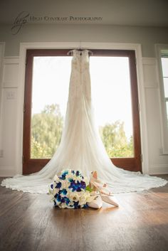 Wedding photo taken by High Contrast Photography. #thedress #thatdress #bouquet #sapphireblue