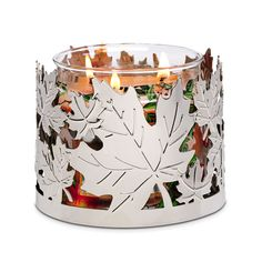 "Maple Leaf Jar Holder. The beauty of autumn is revealed in the artful tracery of maple leaves silhouetted against candlelight. Use with jar candles, sold separately. 3¾""h, 4¾""w. Item #: P92582"