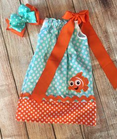 This Super Cute Finding Nemo pillowcase dress would be super cute to celebrate a birthday or just because. Its available in sizes 3 months to 10 years. A 6 inch matching hair bow is also available for an extra $5.00. You may also personalize your dress with a name for an extra $5. If you have any other questions please feel free to contact me.