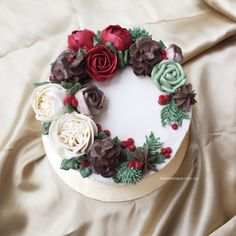 Only for Christmas, buttercream cake with pine cones, roses, ranunculus and berries. I made it; and I love it!! #buttercream #Christmas http://thesweetspot.com.my