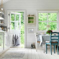 Light and airy summerhouse interiors in Sweden with boho vintage touches.