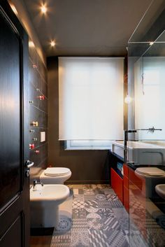Black Bathroom with Mutina Azulej of Urquiola and big mirror