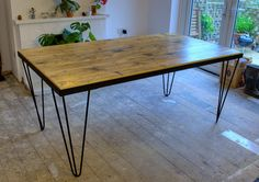 Mid century reclaimed timber table. Steel frame and by Naturalcity