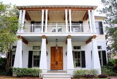 Southern Style: Haint Blue Porch Ceilings on the New Orleans Northshore - TrippaLuka Style Cottage Exterior, Exterior House Colors, Exterior Paint, Door Paint Colors, Paint Colors For Home, House Wrap Around Porch, Front Porch, Haint Blue Porch Ceiling, Porch Lanterns