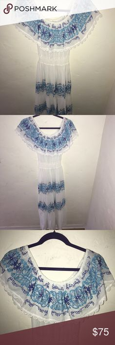 Mediterranean Inspired Dress Looking to escape for a day but don't have the time to jet set? Slip on this off the shoulder white and blue detailed Mediterranean inspired maxi dress! The flow and cinching will make you want to dance on a beach all night or sight see with a beautiful floppy hat! Nightcap Dresses Maxi