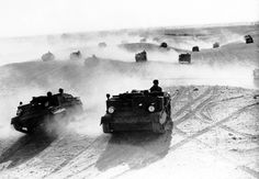 A squadron of Bren gun carriers, manned by the Australian Light Cavalry, rolling through the Egyptian desert in January of 1941 performing maneuvers in preparation for the Allied operations in North Africa.