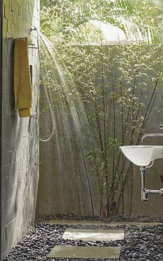 I love the idea of an out door shower next to a master bedroom. Bamboo for privacy, a nice rain shower and sink. Wonder if Derek would let me do this lol.