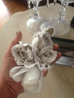 Romantic plaster flowers are easily achieved by mixing plaster of Paris with warm water,  dipping artificial flowers and letting them dry.