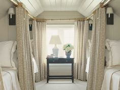 Bedroom with four twin beds with curtains for privacy. Great for guests.
