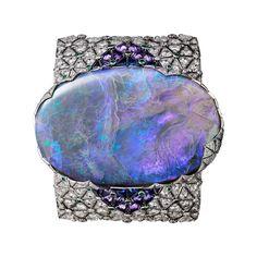 Breathtaking beauty - #Cartier Étourdissant collection bracelet featuring a 189.34 carat #opal alongside #purple #sapphires, #emeralds and #diamonds, set in white gold.