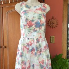 Piper lime collection floral cross back dress Criss cross back, pastel floral dress, also zips in back Piperlime Dresses