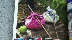 Picture idea!  Picnic with kids wrap lunch on stick.  Add your own lunch and they carry it to the picnic. Cute!