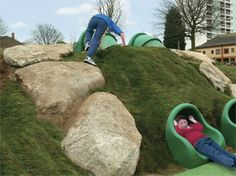 Natural Play scape. kids slide in a hill. slides for kids.