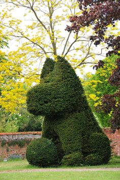 https://flic.kr/p/9FgZv7 | Wingfield, Suffolk | This large puppy with ball stands in the corner of the front garden of Wingfield College.  It is the only piece of figurative topiary in this Medieval/Georgian property and is likened to Jeff Koons's 1992 flower topiary, Puppy.