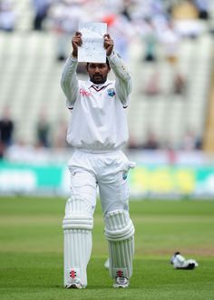 "Denesh Ramdin holds up a message for cameras after getting to his ton at Edgbaston in 2012: ""Yea Viv talk nah""."