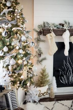 This gold Christmas is so beautiful! Love the mantel and the faux fireplace.