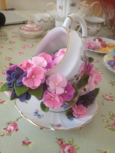 Stacked vintage china with felt flowers