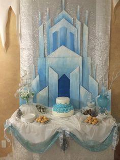 This backdrop is AMAZING for a Frozen birthday party. Elsa's ice castle, Frozen party décor.