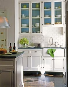 Floors, glass cabinets, blue!, countertops