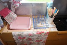 Polly Dolly Vintage: My Vintage Caravan. Pretty kitchen utensils and rubber gloves seen as they are always on display