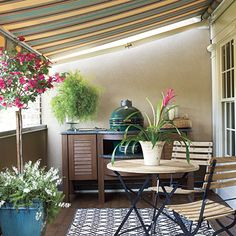 A retractable awning turns this patio into an Entertaining Porch - Southern Living