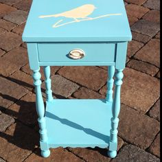 Blue ocean breeze painted side table with bird on branch