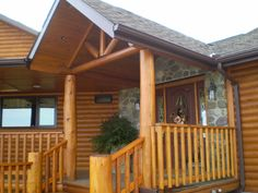 Riverbend Log Homes call 1(800)561-3000 or visit us at www.riverbendloghomes.com Building A Porch, White Cedar, Log Homes, Cabin, House Styles, Outdoor Decor, Ideas, Design, Home Decor