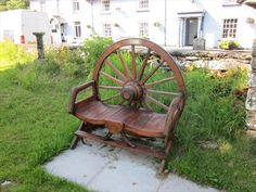 Tractor seats wagon wheels and tractors on pinterest for Things to do with old wagon wheels