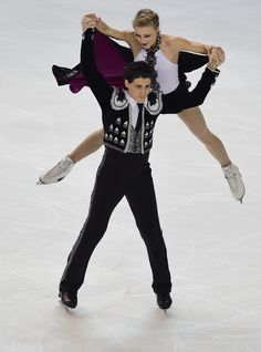 Paul Poirier and Piper Gilles Photos Photos - Piper Gilles and Paul Poirier of Canada of USA  performs during the Ice Dance Short Dance during day one of Trophee Eric Bompard ISU Grand Prix of Figure Skating at the Meriadeck Ice Rink on November 21, 2014 in Bordeaux, France. - ISU Grand Prix of Figure Skating: Day 1