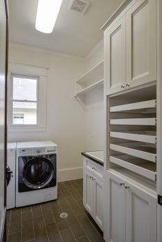 Comfortable traditional laundry room with sweater drying rack décor
